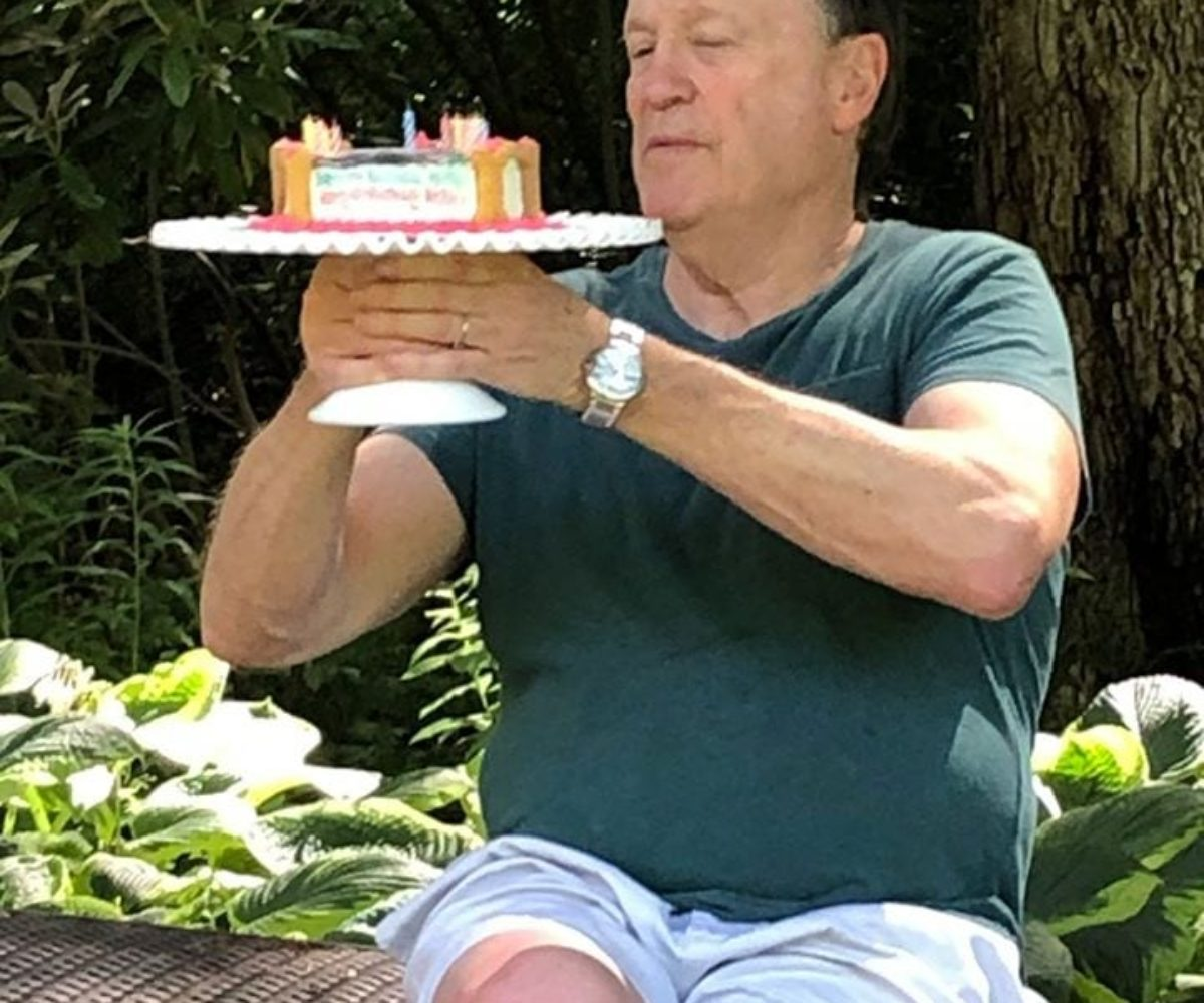 dad at dog party with cake